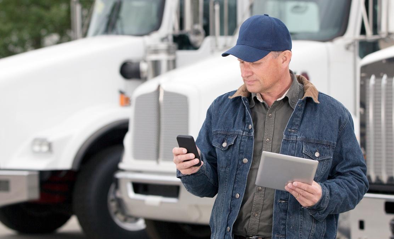 middle aged man in blue denim jacket uses iot hardware