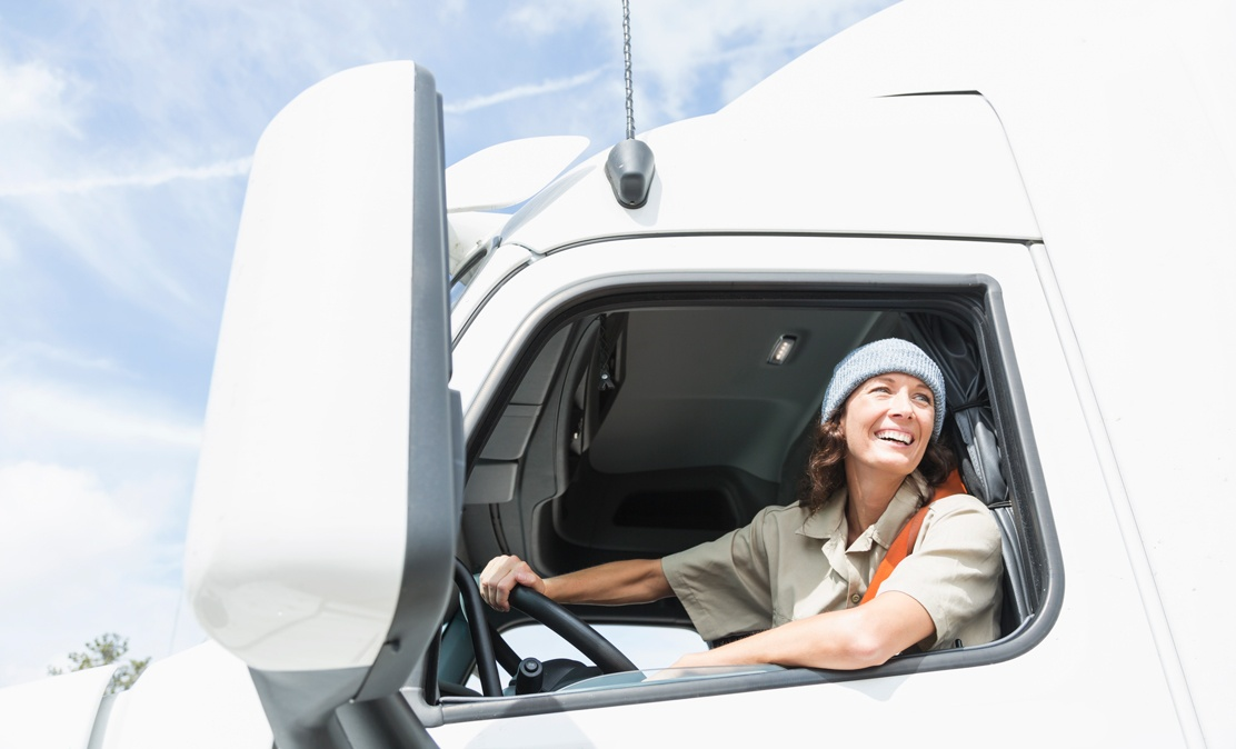 KORE_IoT-Location-Based-Services_Female_truck_driver_in_cab-1